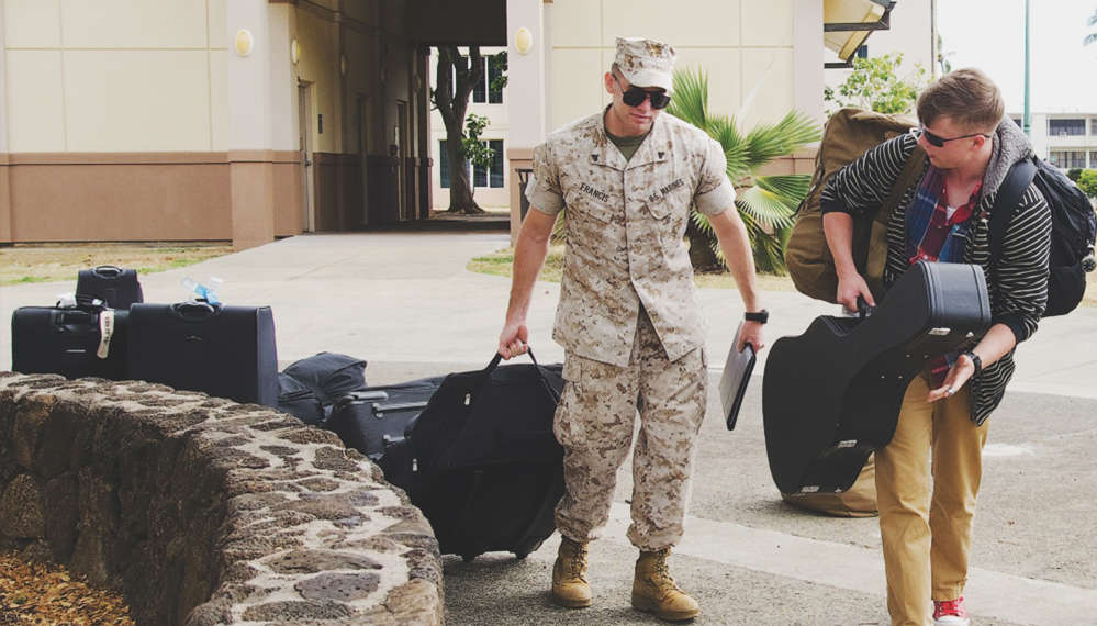 Cpl. Tyler Francis, a Chinese linguist with 3rd Radio Battalion, assists Cpl. Parker Chlovechok, a radio reconnaissance team slackman with Detachment 31, 3rd Radio Bn., with his luggage in front of building 7047, May 8. Marines with Detachments 31 and 5 r