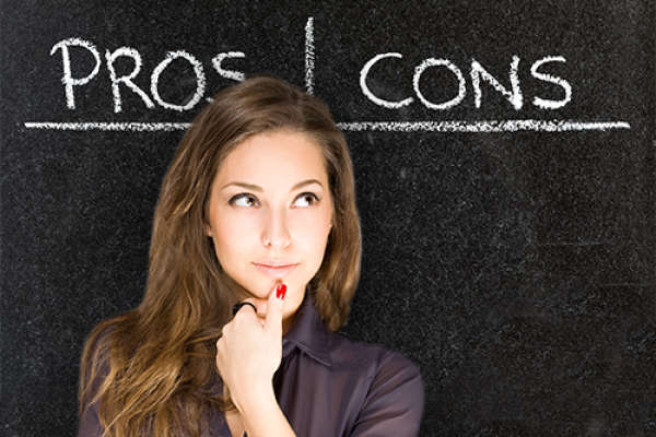 Woman in front of blackboard with the words Pros and Cons written, considering anxiety medication